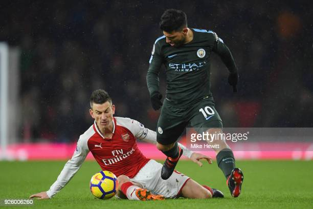 Laurent Koscielny of Arsenal in action with Sergio Aguero of Manchester City during the Premier League match between Arsenal and Manchester City at...