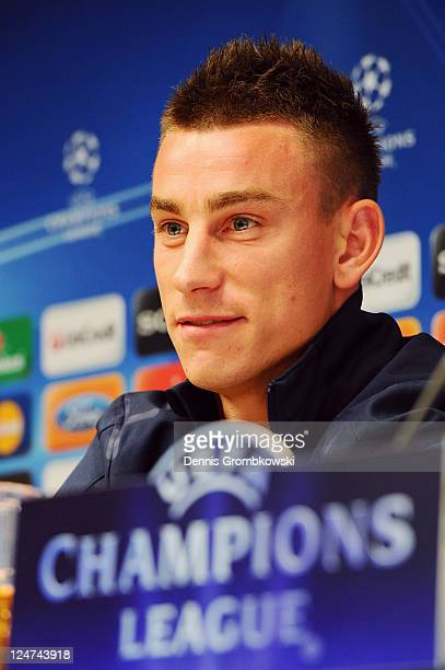 Laurent Koscielny of Arsenal is interviewed during a Press Conference ahead of their UEFA Champions League Group match against Borussia Dortmund at...