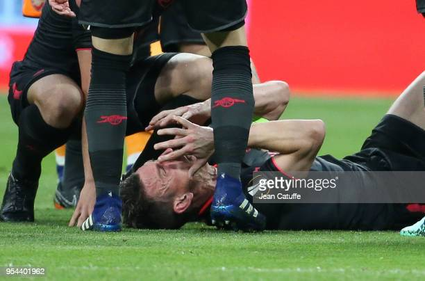 Laurent Koscielny of Arsenal is seriously injured during the UEFA Europa League Semi Final second leg match between Atletico Madrid and Arsenal FC at...