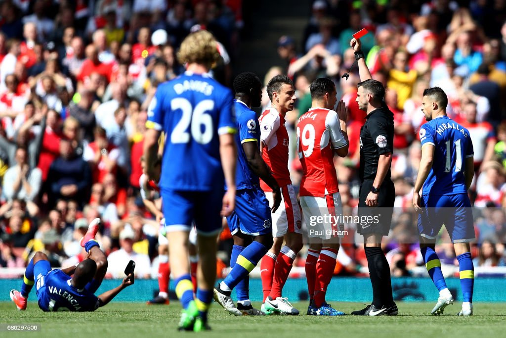 Laurent Koscielny of Arsenal is shown a red card by referee Michael Oliver during the Premier League match between Arsenal and Everton at Emirates Stadium on May 21, 2017 in London, England.