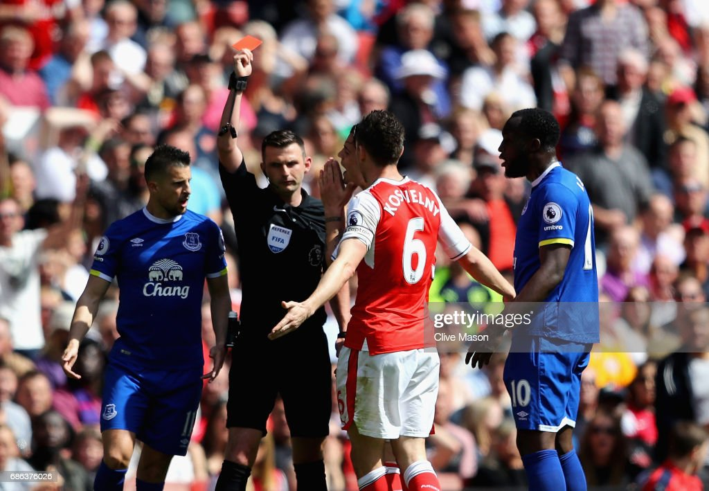 Laurent Koscielny of Arsenal is shown the red card during the Premier League match between Arsenal and Everton at Emirates Stadium on May 21, 2017 in London, England.