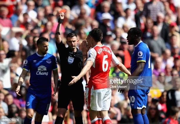 Laurent Koscielny of Arsenal is shown the red card during the Premier League match between Arsenal and Everton at Emirates Stadium on May 21, 2017 in...