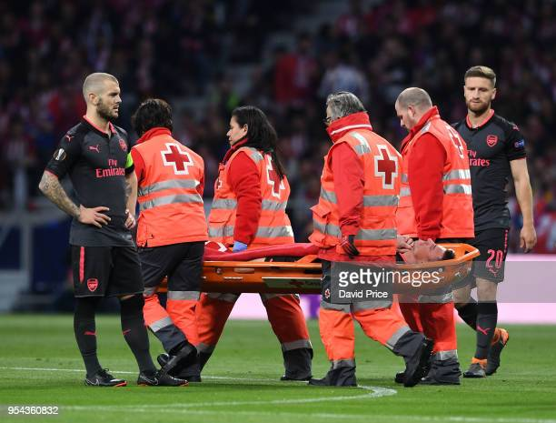 Laurent Koscielny of Arsenal is stretchered from the pitch during the UEFA Europa League Semi Final second leg match between Atletico Madrid and...