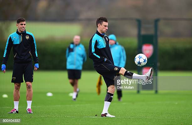 Laurent Koscielny of Arsenal juggles the ball watched by Gabriel Paulista during an Arsenal training session ahead of the UEFA Champions League match...