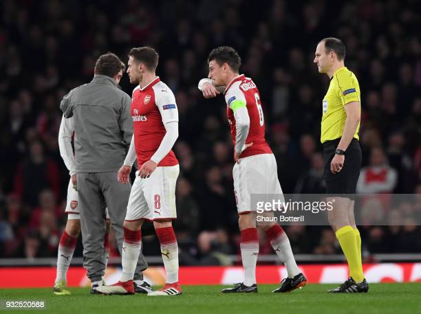 Laurent Koscielny of Arsenal leaves the pitch injured during the UEFA Europa League Round of 16 Second Leg match between Arsenal and AC Milan at...