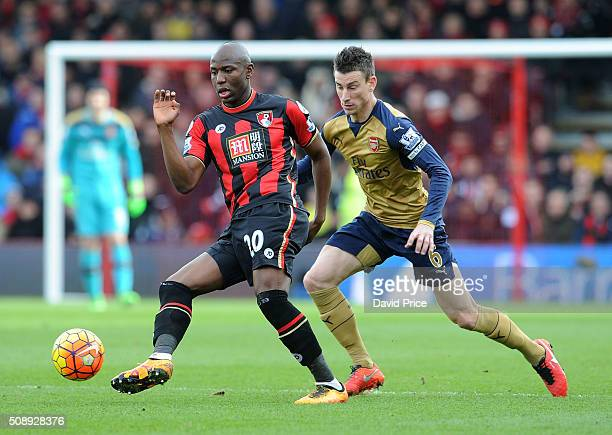 Laurent Koscielny of Arsenal marks Benik Afobe of Bournemouth during the Barclays Premier League match between AFC Bournemouth and Arsenal at The...