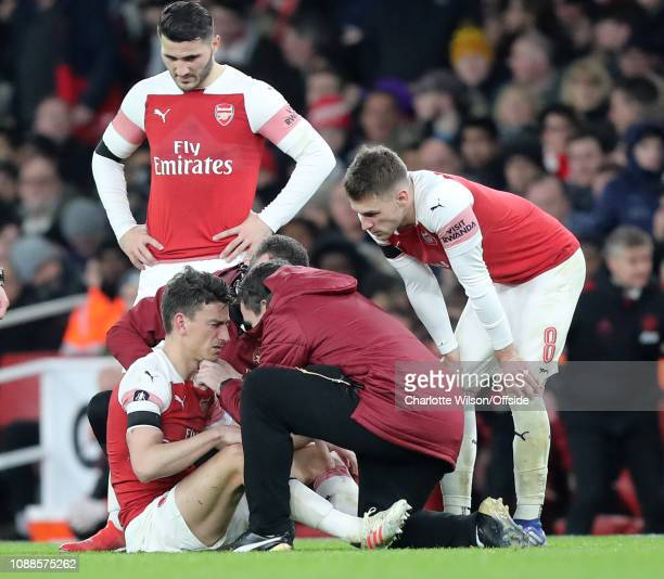 Laurent Koscielny of Arsenal receiving treatment for a head injury during the FA Cup Fourth Round match between Arsenal and Manchester United at...