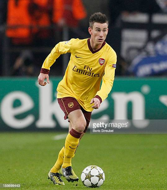 Laurent Koscielny of Arsenal runs with the ball during the UEFA Champions League group B match between FC Schalke 04 and Arsenal FC at VeltinsArena...