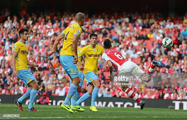 Laurent Koscielny of Arsenal scores a goal during the Barclays Premier League match between Arsenal and Crystal Palace at Emirates Stadium on August...