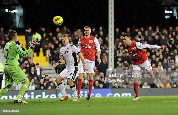 Laurent Koscielny of Arsenal scores a goal for arsenal past David Stockdale of Fulham during the Barclays Premier League match between Fulham and...