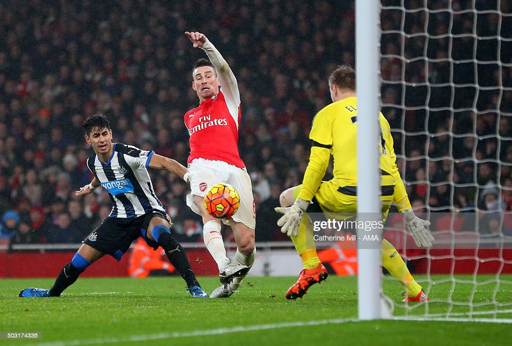 Laurent Koscielny of Arsenal scores a goal to make it 1-0 during the Barclays Premier League match between Arsenal and Newcastle United at Emirates Stadium on January 2, 2016 in London, England.