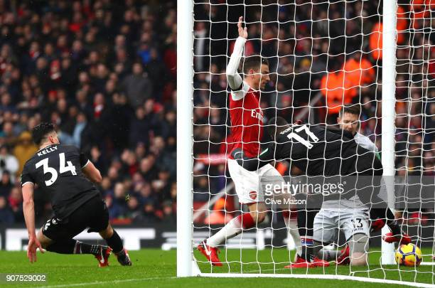 Laurent Koscielny of Arsenal scores his sides third goal during the Premier League match between Arsenal and Crystal Palace at Emirates Stadium on...