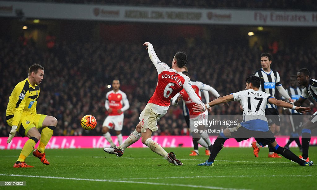 Laurent Koscielny of Arsenal scores his team's first goal past Robert Elliot of Newcastle United during the Barclays Premier League match between Arsenal and Newcastle United at Emirates Stadium on January 2, 2016 in London, England.