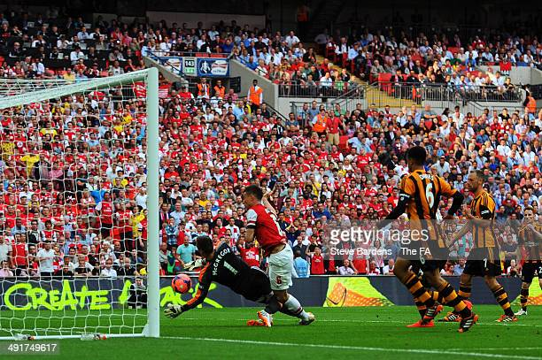 Laurent Koscielny of Arsenal scores his team's second goal during the FA Cup with Budweiser Final match between Arsenal and Hull City at Wembley...