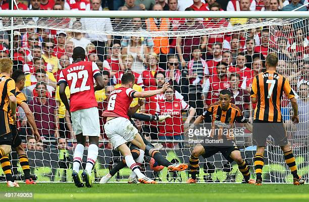 Laurent Koscielny of Arsenal scores their second goal during the FA Cup with Budweiser Final match between Arsenal and Hull City at Wembley Stadium...