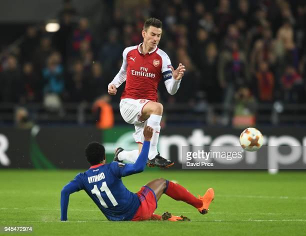 Laurent Koscielny of Arsenal skips past Vitinho of CSKA during the UEFA Europa League quarter final leg two match between CSKA Moskva and Arsenal FC...