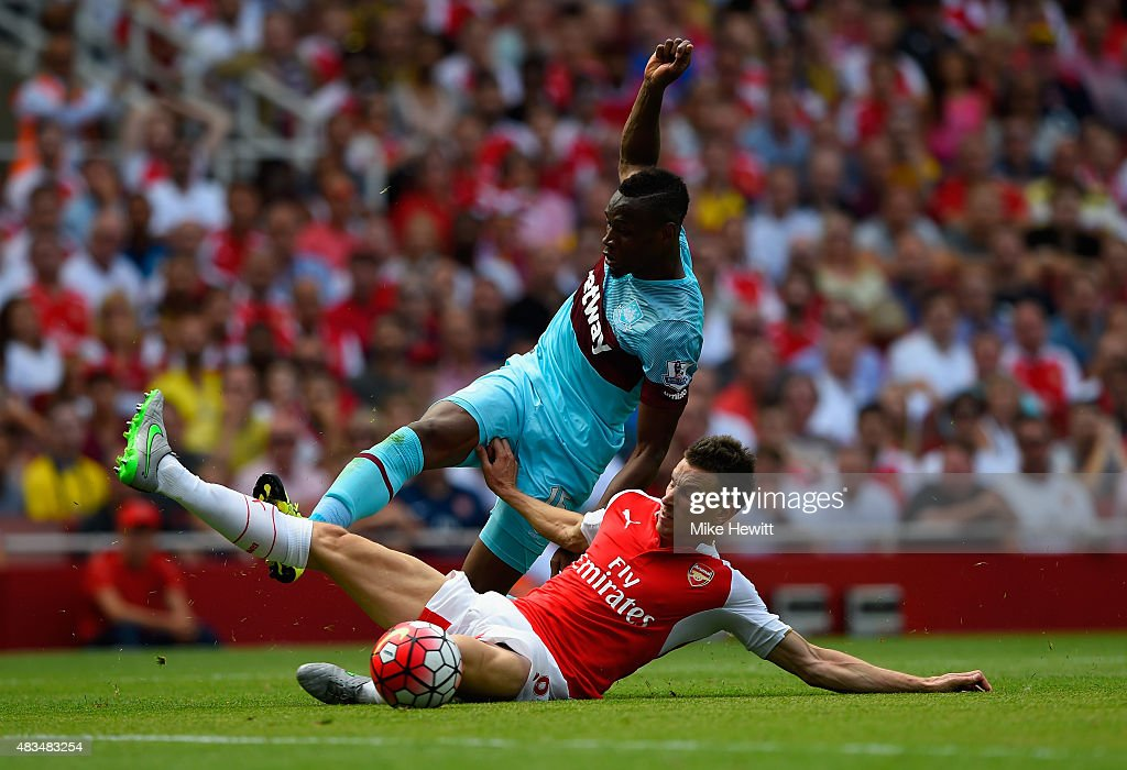 Laurent Koscielny of Arsenal slides in to tackle Diafra Sakho of West Ham United during the Barclays Premier League match between Arsenal and West Ham United at the Emirates Stadium on August 9, 2015 in London, England.
