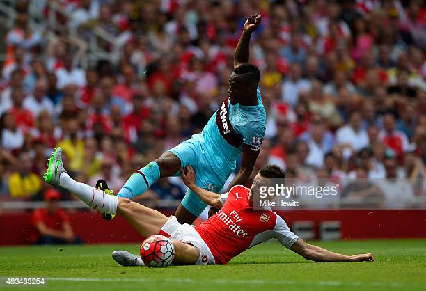 Laurent Koscielny of Arsenal slides in to tackle Diafra Sakho of West Ham United during the Barclays Premier League match between Arsenal and West...
