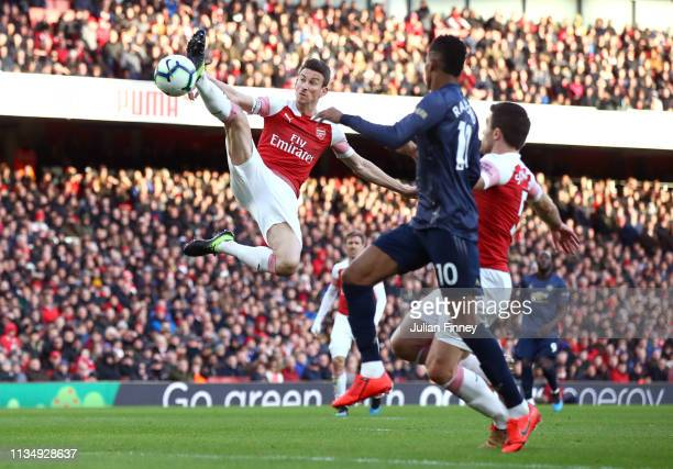 Laurent Koscielny of Arsenal stretches for the ball during the Premier League match between Arsenal FC and Manchester United at Emirates Stadium on...