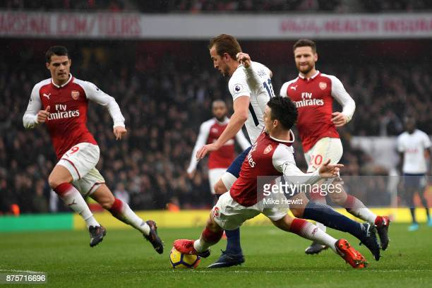 Laurent Koscielny of Arsenal tackles Harry Kane of Tottenham Hotspur during the Premier League match between Arsenal and Tottenham Hotspur at...
