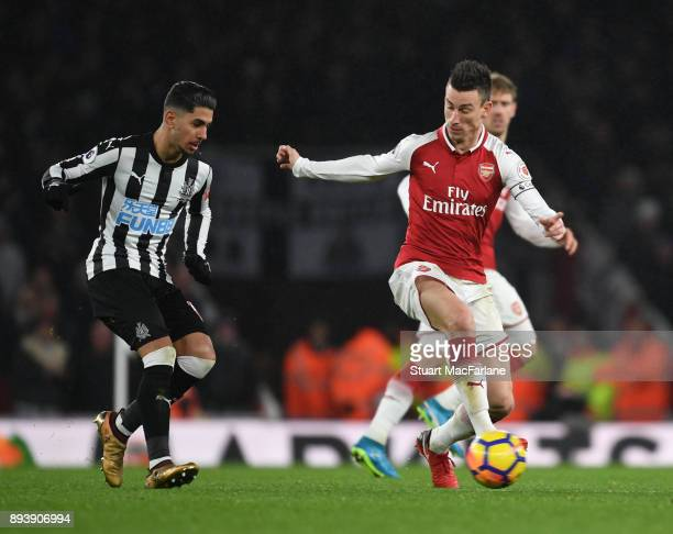 Laurent Koscielny of Arsenal takes on Ayoze Perez of Newcastle during the Premier League match between Arsenal and Newcastle United at Emirates...