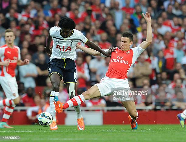 Laurent Koscielny of Arsenal takes on Emmanuel Adebayor of Tottenham during the Barclays Premier League match between Arsenal and Tottenham Hotspur...