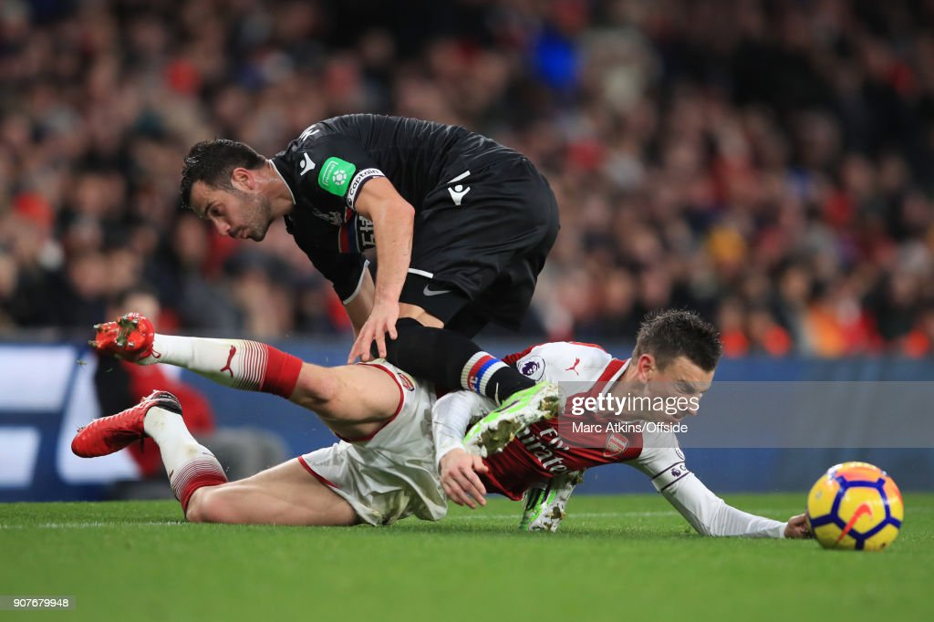 Laurent Koscielny of Arsenal tangles with Luka Milivojevic of Crystal Palace during the Premier League match between Arsenal and Crystal Palace at Emirates Stadium on January 20, 2018 in London, England.
