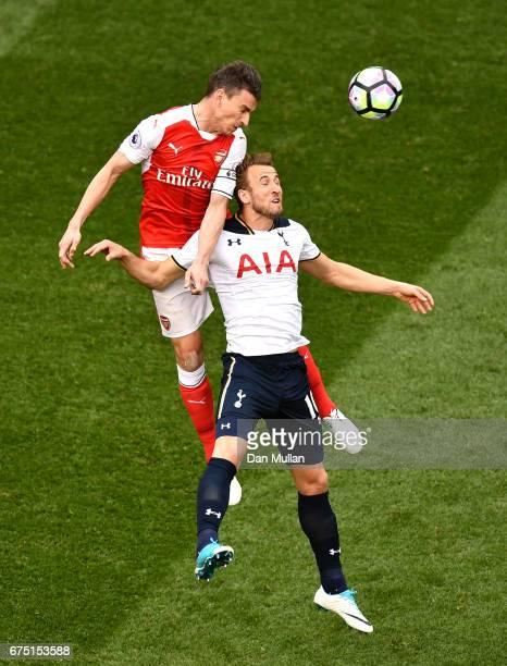 Laurent Koscielny of Arsenal wins a header over Harry Kane of Tottenham Hotspur during the Premier League match between Tottenham Hotspur and Arsenal...