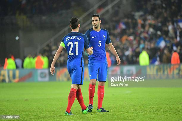 Laurent Koscielny of France and Adil Rami of France after the International friendly match between France and Ivory Coast at Stade BollaertDelelis on...