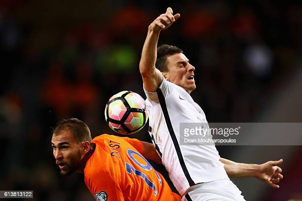 Laurent Koscielny of France and Bas Dost of the Netherlands challenge for the headed ball during the FIFA 2018 World Cup Qualifier between...