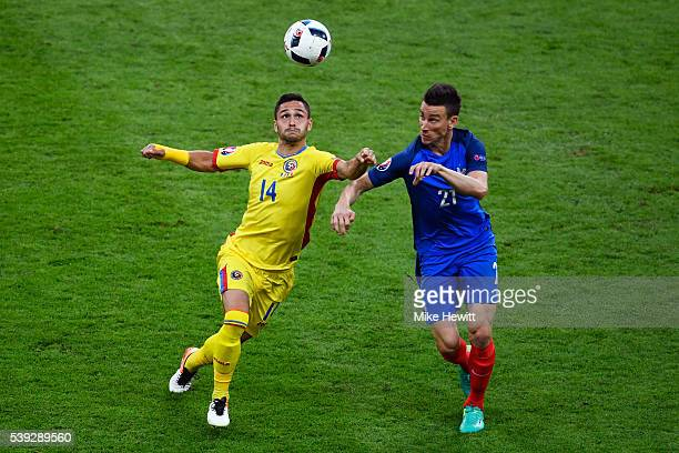 Laurent Koscielny of France and Florin Andone of Romania compete for the ball during the UEFA Euro 2016 Group A match between France and Romania at...
