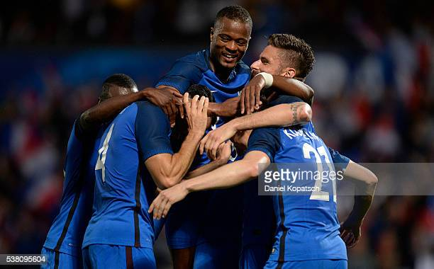 Laurent Koscielny of France celebrates his team's third goal with team mates during the International Friendly between France and Scotland on June 4...
