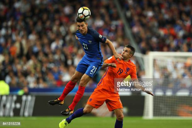 Laurent Koscielny of France competes with Robin van Persie of Netherlands during the FIFA 2018 World Cup Qualifier match between France and The...