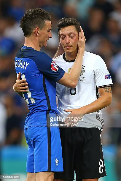 Laurent Koscielny of France consoles Mesut Ozil of Germany at the end of the UEFA Euro 2016 Semi Final match between Germany and France at Stade...