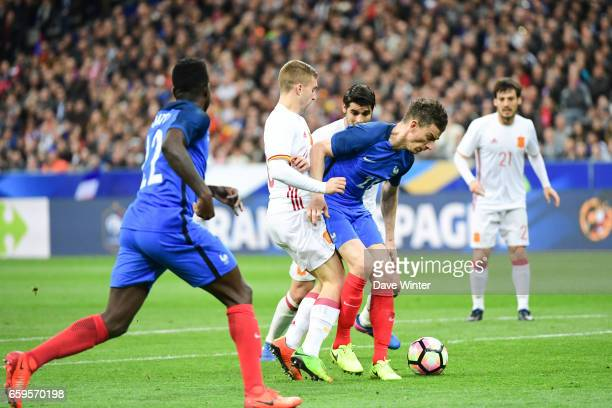 Laurent Koscielny of France is adjudged to have fouled Gerard Deulofeu of Spain resulting in a penalty during the friendly match between France and...