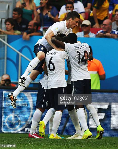Laurent Koscielny of France joins in on Paul Pogba's goal celebration during the 2014 FIFA World Cup Brazil Round of 16 match between France and...
