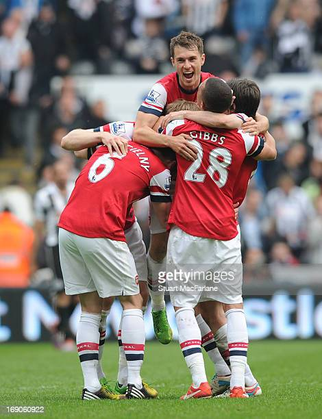 Laurent Koscielny Per Mertesacker Aaron Ramsey Kieran Gibbs and Thomas Rosicky celebrate the Arsenal victory after the Barclays Premier League match...