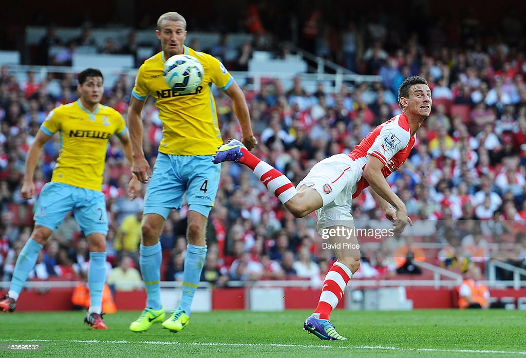 Laurent Koscielny scores a goal for Arsenal under pressure from Brede Hangeland during the Barclays Premier League match between Arsenal and Crystal Palace at Emirates Stadium on August 16, 2014 in London, England.