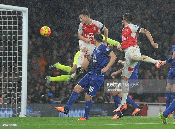 Laurent Koscielny scores Arsenal's 2nd goal under pressure from Tim Howard and Gareth Barry of Everton during the Barclays Premier League match...