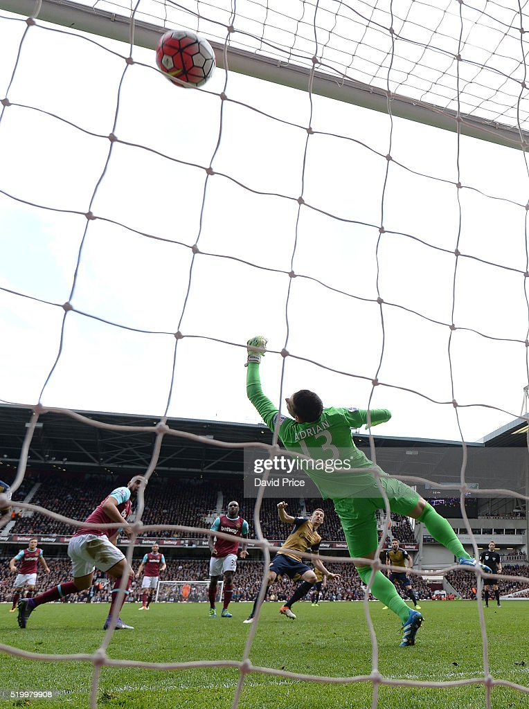 Laurent Koscielny scores Arsenal's 3rd goal past Adrian of West Ham during the Barclays Premier League match between West Ham United and Arsenal at The Boleyn Ground, on 9th April 2016, in London, England