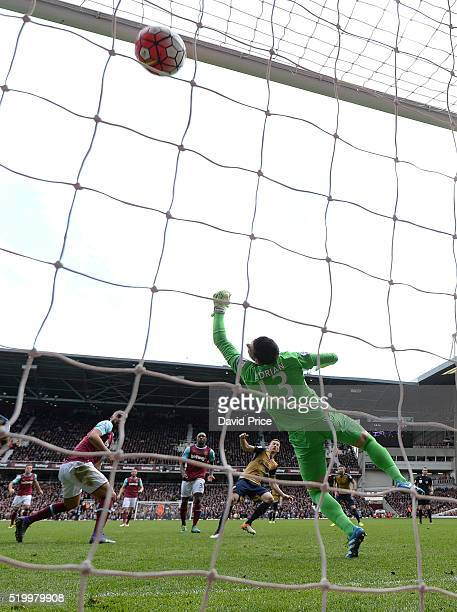 Laurent Koscielny scores Arsenal's 3rd goal past Adrian of West Ham during the Barclays Premier League match between West Ham United and Arsenal at...