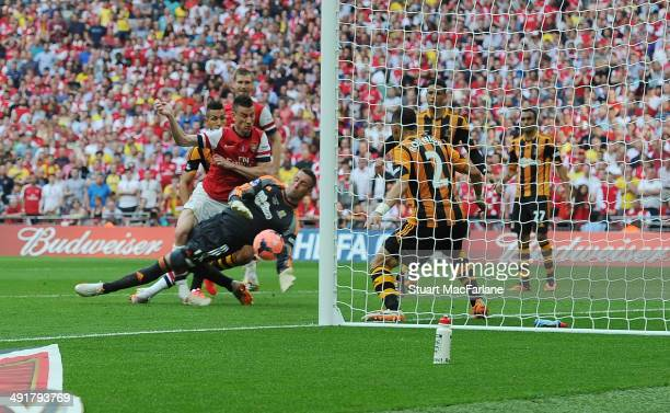Laurent Koscielny shoots past Hull goalkeeper Alan McGregor to score the 2nd Arsenal goal during the FA Cup Final between Arsenal and Hull City at...