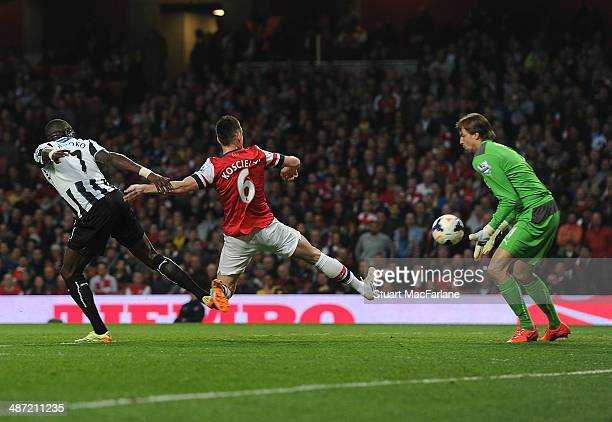 Laurent Koscielny shoots past Newcastle goalkeeper Tim Krul to score for Arsenal during the Barclays Premier League match between Arsenal and...