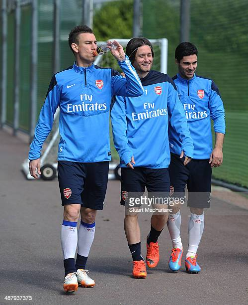 Laurent Koscielny, Tomas Rosicky and Mikel Arteta of Arsenal before a training session at London Colney on May 3, 2014 in St Albans, England.