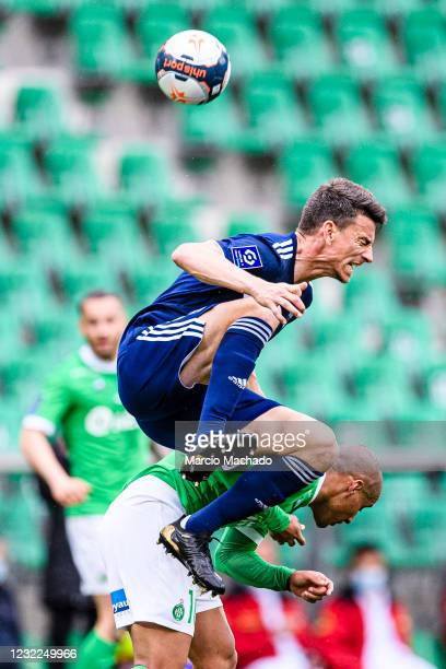 Laurent Koscienly of Bordeaux fights for the ball with Wahbi Khazri of Saint-Étienne during the Ligue 1 match between AS Saint-Etienne and Girondins...