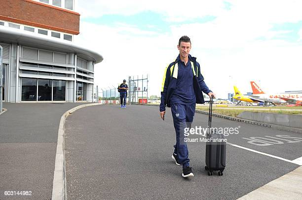 Laurent Koscileny boards the Arsenal plane to Paris at Luton Airport on September 12 2016 in Luton England