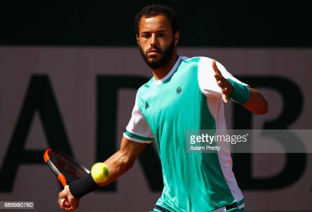 Laurent Lokoli of France plays a forehand during the mens singles first round match against Martin Klizan of Slovakia on day three of the 2017 French...