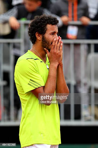 Laurent Lokoli of France reacts after his defeat in his men's singles match against Steve Johnson of the United States on day four of the French Open...