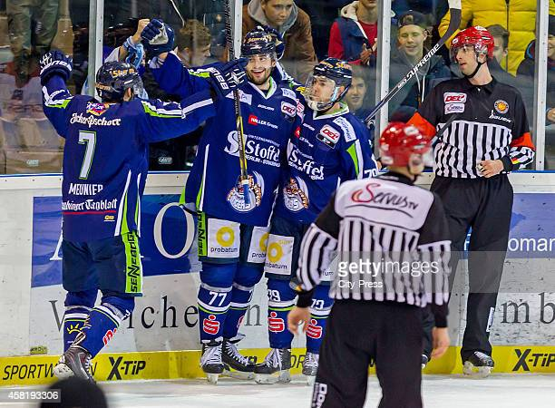 Laurent Meunier, Sacha Treille and Blaine Down of the Straubing Tigers celebrate after scoring the 5:1 during the game between Straubing Tigers and...