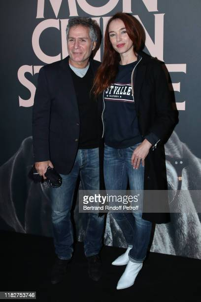 Laurent Olmedo and Delphine Rollin attend the Mon Chien Stupide premiere at UGC Normandie on October 22 2019 in Paris France